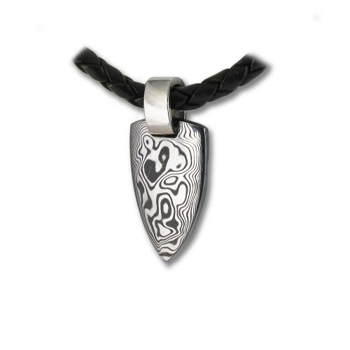 Bear's Tooth Damascus Steel Handcrafted Pendant from Rovaniemi in Finnish Lapland. Buy Damastikoru Jewelry from Nordic-Gift.com.