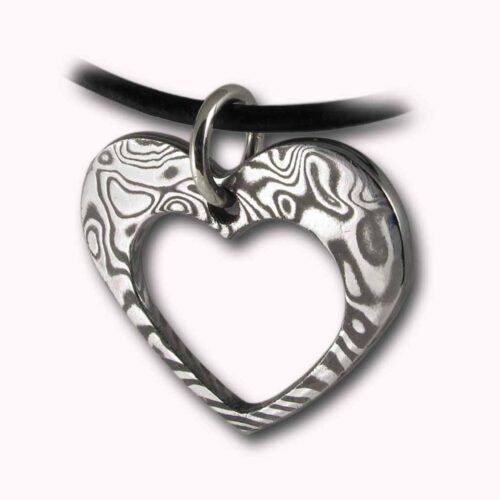 Heart (within a) Heart Damascus Steel Handcrafted Pendant from Rovaniemi in Finnish Lapland. Buy Damastikoru Jewelry from Nordic-Gift.com.